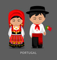 portugueses in national dress with a flag vector image vector image