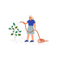 girl watering plants with hose young woman vector image vector image