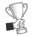trophy cup prize in hand sketch engraving vector image vector image