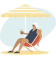 old senior lady enjoying a coconut cocktail vector image vector image