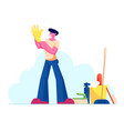 young man put on yellow rubber glove on hand stand vector image vector image