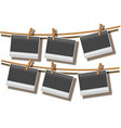 photo frames hanging on rope vector image