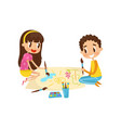 cute little kids sitting on the floor and drawing vector image vector image