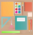 school supplies on a wooden work table top view vector image vector image
