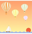 aerostats flying in sky over the sea at sunset vector image