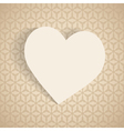 a paper heart on the beige background vector image vector image
