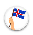iceland flag in hand round icon vector image vector image