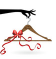 hand hold hanger with ribbon vector image vector image