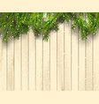 christmas tree branches on light wooden background vector image