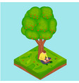 a man is sitting an apple tree with laptop