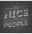 slogan on brickwall be nice to people vector image vector image
