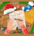 child hand pen writing letter to santa claus vector image