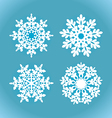White snowflakes on a blue background vector image vector image