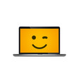 yellow emoji smiling on laptop screen vector image