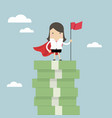 businesswoman with winners flag standing on money vector image vector image