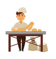 young baker kneads dough and makes bread loafs vector image