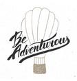 be adventurous in vintage style handwritten vector image