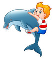 little boy cartoon with dolphins vector image