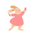 cute bunny holding brush and painting egg vector image