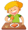 happy boy eating on the table vector image vector image