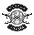 viking shield and crossed swords emblem vector image