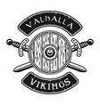 viking shield and crossed swords emblem vector image vector image