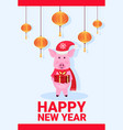 pig holding gift box wearing hat holiday balls vector image vector image