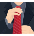 businessman in a suit straightens his tie vector image