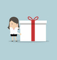 businesswoman holding a big gift box for christmas vector image