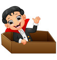 funny dracula in a coffin while waving hand isolat vector image