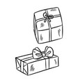 hand drawn gift boxes doodles vector image