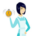 young asian cleaner holding alarm clock vector image vector image