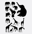 elephant and giraffe animal silhouettes vector image vector image