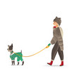 cartoon woman walking at dog cold weather vector image vector image