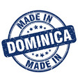 made in dominica blue grunge round stamp vector image vector image