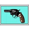 The pop art Gun on a polka-dot background