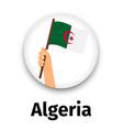 algeria flag in hand round icon vector image