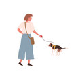young cheerful woman walking dog on leash female vector image vector image