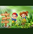 cartoon of little farmer standing beside signpost vector image
