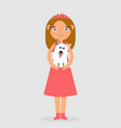 happy girl holding a dog in her arms and smiling vector image vector image