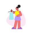 woman at clothes shop vector image
