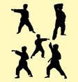karate kids silhouette vector image vector image