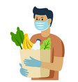 man in mask and gloves holds bag groceries vector image