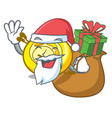 santa with gift cd player mascot cartoon vector image vector image