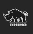 angry rhino monochrome logo on a dark background vector image