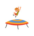 happy boy jumping on trampoline smiling little vector image vector image
