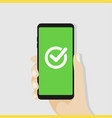 green checkmark on smartphone screen vector image vector image