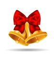 Golden bells with red bow on white background
