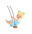 happy blonde girl swinging on a rope swing little vector image vector image