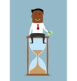 Businessman sitting with money on hourglass vector image